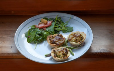 Pastry with asparagus, tofu filling, rhubarb and spinach salad